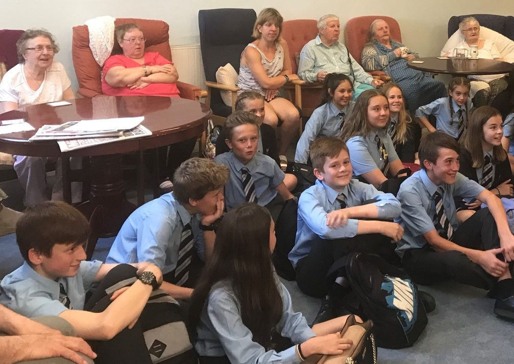 Older people from Age UK are in an audience with young people from West Exe Technology College